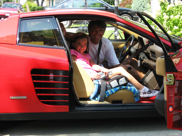 Franck Freon with his daughter Isabella in red Ferrari